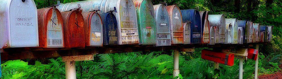 Photo of mailboxes signifying the fact that snail-mail is not dead.