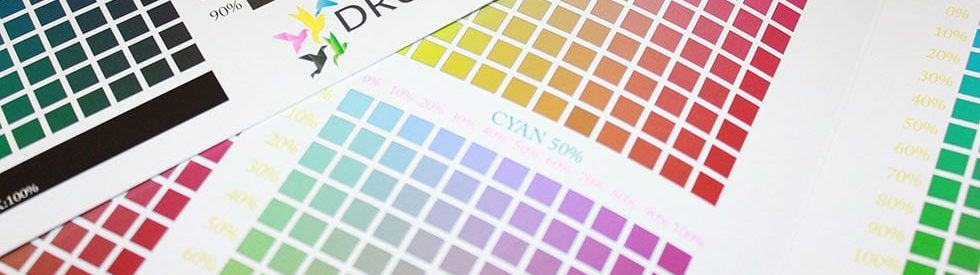 Photo of cmyk ink charts shows our background in sleuthing color issues and challenges.